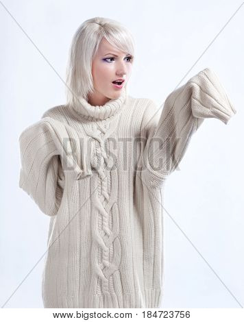 Portrait of a surprised girl in woolen cashmere sweater
