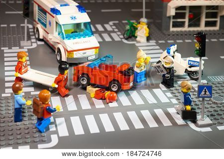 MOSCOW, DEC,25, 2016: Lego City scene road accident driver violation of traffic regulations at zebra crossing priority for pedestrian. Violation of traffic safety rule Example for children advertising