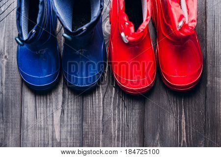 Red and Blue Rubber boots for rainy day. Autumn kids boots concept