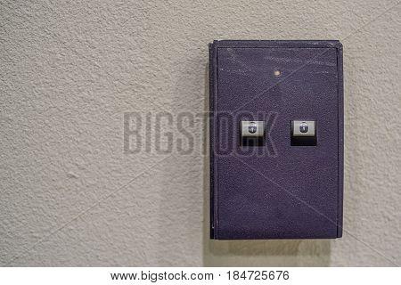 Door access keypad console on grey wall