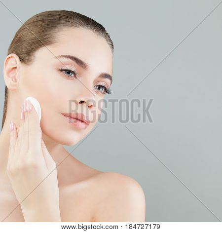Perfect Healthy Woman with White Cotton Pads. Hygienic Cleansing and Facial Treatment Concept