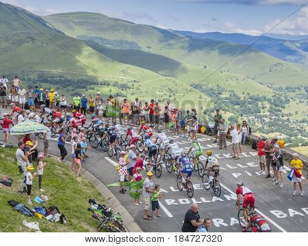 Col de PeyresourdeFrance- July 23 2014: The peloton climbing the road to Col de Peyresourde in Pyrenees Mountains during the stage 17 of Le Tour de France on 23 July 2014.
