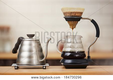 Coffee brewing gadgets on wooden bar counter. Coffee concept. Preparing fresh strong coffee drink.