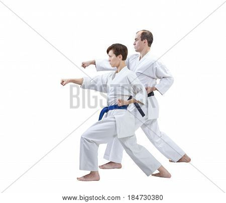 With black belt and blue belt the athletes are training punch arm