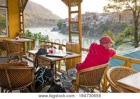 Tourist looking at a great view at the river Ganges at Laxman Jhula in India