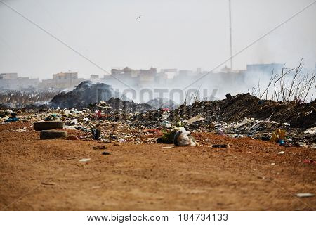 Burning garbage heap of smoke from a burning pile of garbage in senegal.