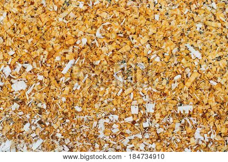 horizontal closeup of brown sawdust texture wood remains