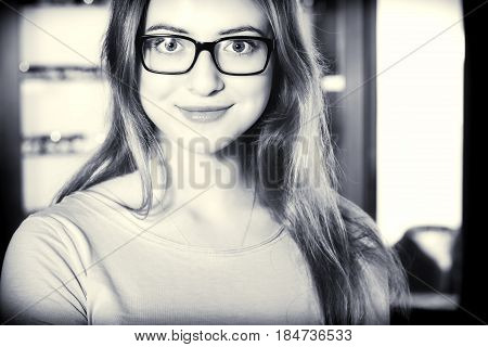 Woman With Glasses In The Optical Salon