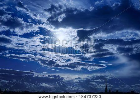 City silhouette under dark blue dramatic surreal sky. Saint Petersburg Russia.