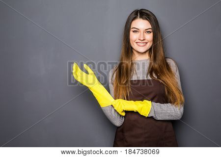 Young Smile Woman Wearing Rubber Gloves On Grey Background