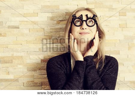 Amazed Woman With Glasses Shaped Into Sale Text