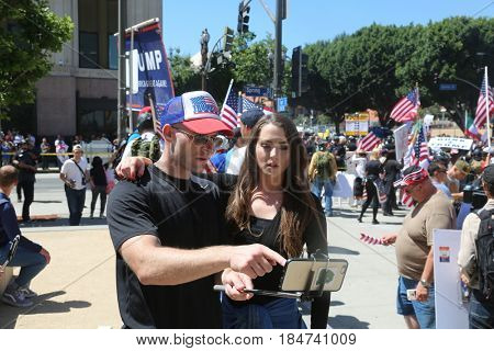 LOS ANGELES California- May 1, 2017: May Day Immigration Protest Rally Against President Donald J. Trump on May 1, 2017 in Los Angeles, California.