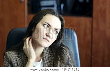 Young Business Woman With Hand Rubbing Neck And Shoulders To Relieve Stress In The Office