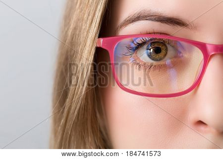 Closeup Of And Eye Of Blonde Woman With Pink Glasses