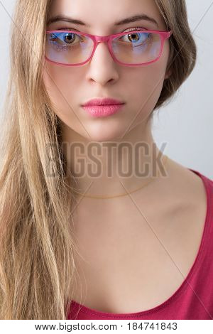 Portrait Of Young Wooman With Pink Glasses, Lips And Shirt