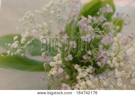 Very delicate spring bouquet of lilies of the valley and forget-me-nots