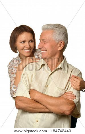 Portrait of an elderly father with an adult daughter