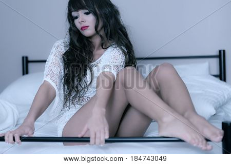 Attractive Brunette Woman On A Bed