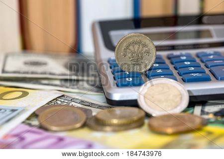Usa Coin, Euro Cent, One Pound Lying On Dollar And Euro Bills, Calculator, Pen.
