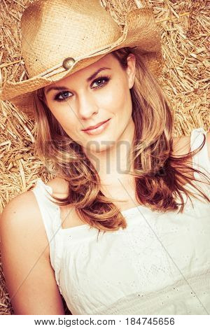 Woman wearing country cowboy hat