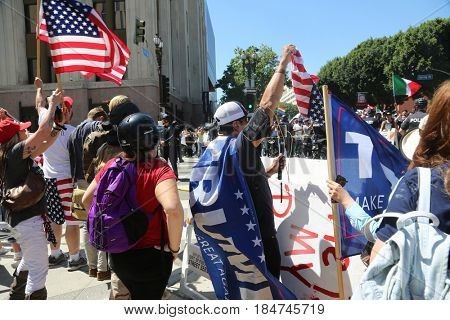 LOS ANGELES California- May 1, 2017: May Day Supporters of President Donald J. Trump. People March with signs and chant slogans on May 1, 2017 in Los Angeles, California.