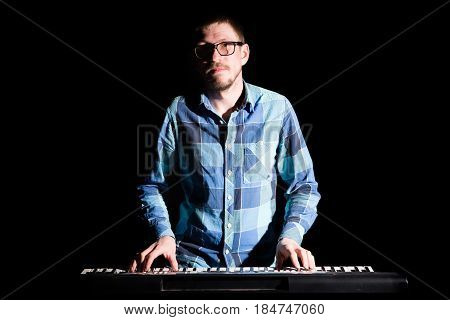 Musician Playing On Keyboard Electric Piano On Dark. Musician Concept