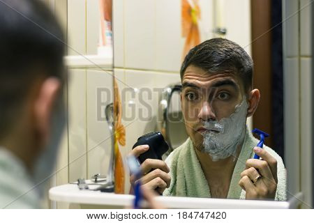The Man In Front Of A Select Electric Shaver Or Razors Classic
