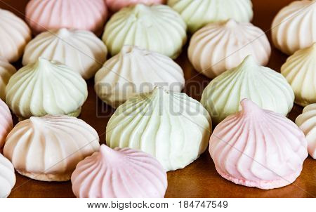 Small spiral meringues on table. Selective focus