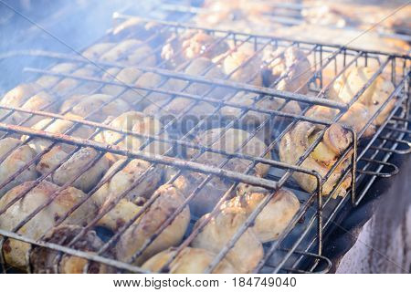 Champignon White Mushrooms Grilled On Grill Or Barbecue In Smoke Coals