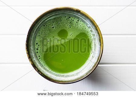 Green matcha tea in bowl.