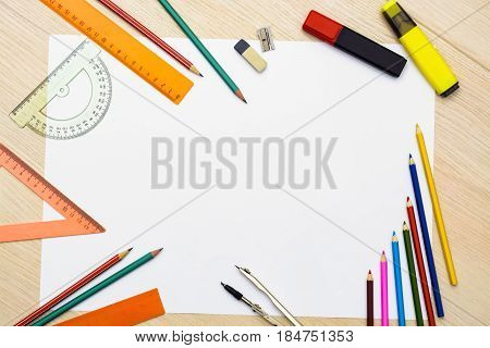 Set of pencils erasers post-its and other useful supplies for the school. There is a centered blank sheet for text writing. Back to school