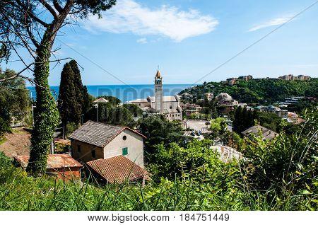 panorama of small town Arenzano in Liguria and famous church 'Gesù Bambino di Praga' in the background