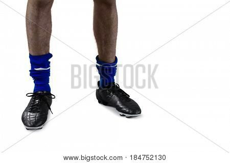 Low section of football player with football boots and socks against white background