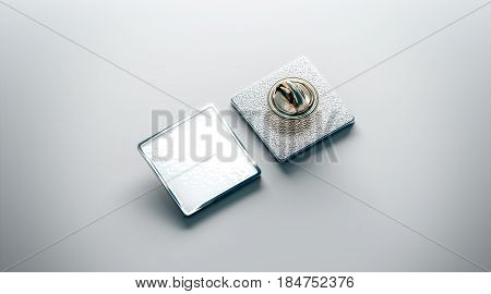 Blank white lapel pin mockup front and back side view 3d rendering. Empty luxury hard enamel badge mockup. Silver clasp-pin design template. Matal square brooch for logo presentation.