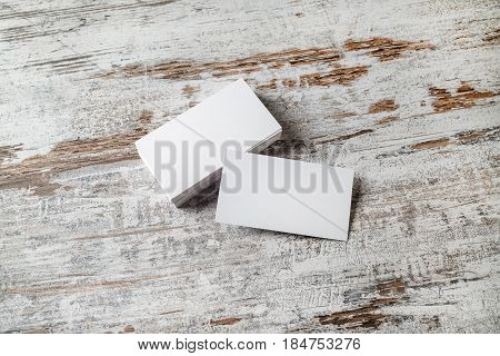 Blank business cards on wood background. Mockup for branding identity. Stack of blank name cards. Blank template for design presentations and portfolios. poster