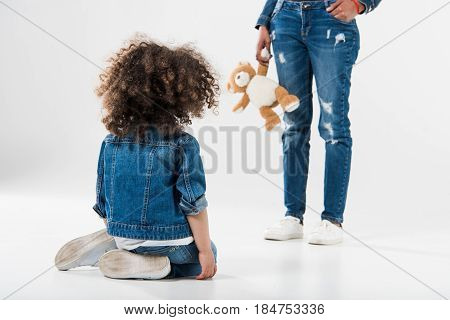 Mother With Toy Standing With Daughter
