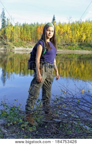 Beautiful girl travels along the river Big Yugan in the taiga Siberia