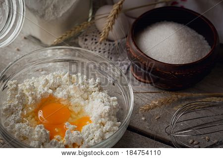 Fresh dairy products. Milk cottage cheese sour cream fresh eggs and wheat on rustic wooden background. Organic farming dairy concept.