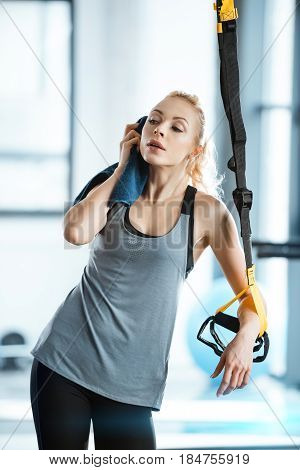Beatiful Fitness Woman Resting During Training With Trx Fitness Straps