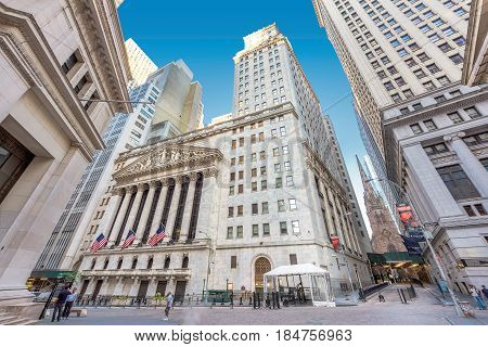 View of Wall Street and New York Stock Exchange on a sunny day on June 25, 2016 in New York, NY.