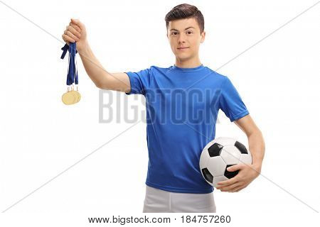 Teenage soccer player with gold medals and a football isolated on white background