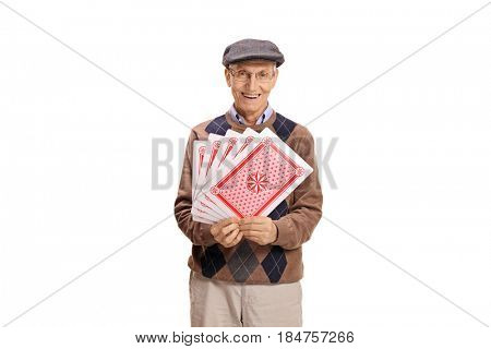 Senior with playing cards looking at the camera and smiling isolated on white background