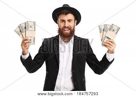 Excited bearded man with bundles of money isolated on white background