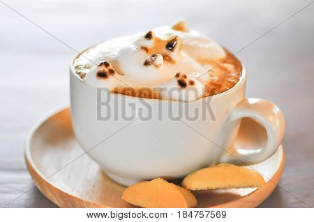 dog shaped milk foam in a cup of coffeedog foam latte art