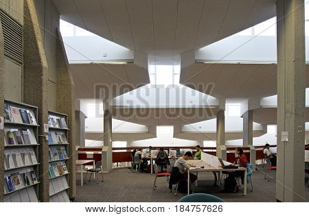 BEER SHEVA ISRAEL - AUGUST 12 2015: Students study in the library of Ben Gurion University Beer Sheva. Architectural style brutalism