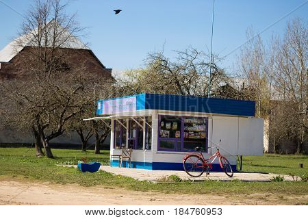 GOMEL BELARUS - May 3 2017: A small village shop stalls with a bicycle parked next to it.