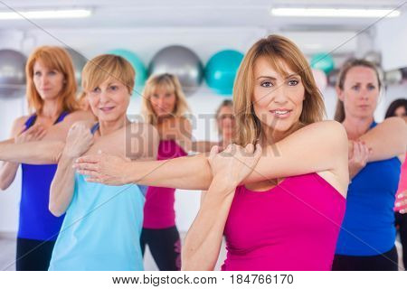 fit healthy women doing exercise stretching class