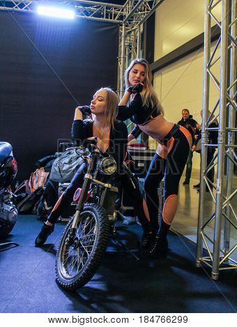 St. Petersburg Russia - 15 April, Girls on a motorcycle,15 April, 2017. International Motor Show IMIS-2017 in Expoforurum. Models on motorcycles presented at the motor show.