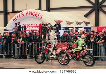 St. Petersburg Russia - 15 April, Spectators and moto-sportsmen,15 April, 2017. International Motor Show IMIS-2017 in Expoforurum. Visitors and participants of the annual moto-salon in St. Petersburg.