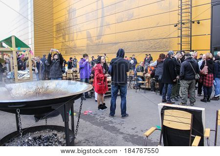St. Petersburg Russia - 15 April, People snacking on the street,15 April, 2017. International Motor Show IMIS-2017 in Expoforurum. Visitors to a motor show in an improvised street food station.